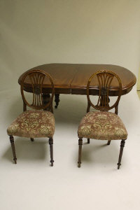 A Victorian mahogany extending dining table, with three leaves, length 310 cm, together with ten chairs. (11)