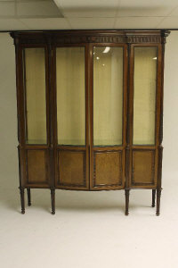 A Victorian mahogany display cabinet on reeded legs, width 153 cm.