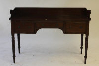 An early nineteenth century mahogany desk, fitted with three drawers on reeded legs, width 140 cm.