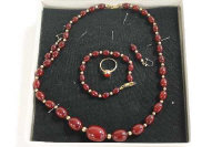 A 9ct gold-mounted beaded necklace, together with the matching dress ring, pair of earrings and bracelet. (5)