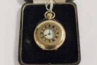 A 9ct gold half-hunter pocket watch.