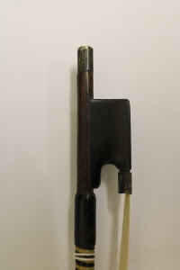 A violin bow by James Tubbs, mounted in white metal with ebony frog, length 74 cm.