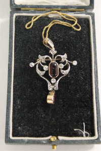 A late Victorian diamond and amethyst pendant on 9ct gold chain.