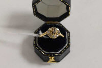An Edwardian diamond cluster ring.