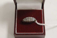 An Edwardian diamond boat-shaped ring.