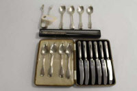 Eight silver tea spoons, together with a set of six silver handled butter knives, a bread knife and pair of silver sugar tongs.