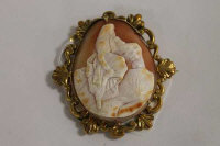 A late Victorian cameo brooch mounted in yellow metal.