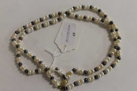 A double-strand of two-tone cultured pearls on 9ct gold clasp.
