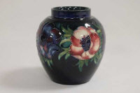 A Moorcroft vase decorated with  amaryllis, height 13 cm.