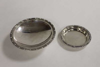 A silver dish on raised foot, Birmingham 1965, together with a small silver dish of the same period and style. (2)