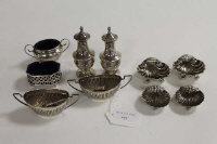 Two pairs of silver shell salts, together with six other small silver salts and pepper pots. (10)