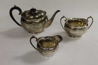 A silver three piece tea service, Sheffield 1925, 39 oz. (3)