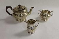 A three piece silver tea service, Birmingham 1934, 31 oz. (3)