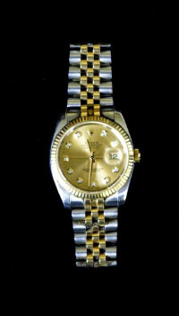 A Gentleman's Oyster Perpetual Datejust Rolex watch, the bi-metal gold and steel strap with diamond set dial, boxed.
