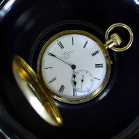 An 18ct gold half hunter pocket watch by Dent, Royal Exchange London.