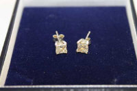 A pair of 18ct white gold princess-cut diamond stud earrings. (2)