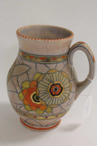 A Crown Ducal Charlotte Rhead tube-lined water jug, height 21 cm.