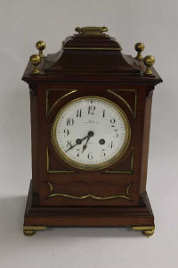 A mahogany and brass mounted bracket clock by Dent, Royal Exchange London, height 34 cm.