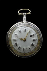 An early nineteenth century French verge pocket watch, the enamel dial surrounded by  a gilt metal border set with rubies.