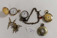 A white metal pocket on chain with fob, together with three gilt metal pocket watches and a collection of pocket watch keys.