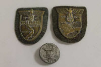 Two early Third Reich Kuban and Krim campaign shields, together with a 1938 Labour Day badge.. (3)