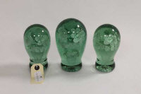 Three 19th century green glass dumps. (3)
