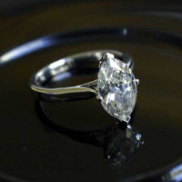 An 18ct white gold marquise diamond ring, approximately 2.5ct, colour H, Vs2.