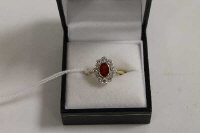 An 18ct gold diamond and ruby cluster ring.