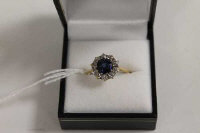 An 18ct gold diamond and sapphire cluster ring.