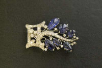 An Art Deco diamond and sapphire clip brooch.