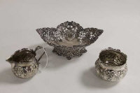 A silver bon-bon dish with pierced decoration, Sheffield 1898, together with a silver cream jug and sugar pot. (3)