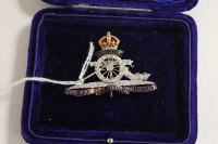 A Royal Artillery diamond and enamel brooch.