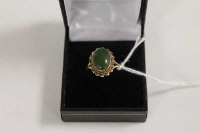 A 9ct gold cabochon jade ring.