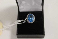 A 9ct white gold blue topaz ring set with diamonds.