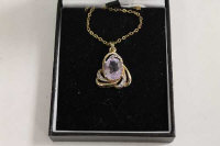 A 9ct gold amethyst and diamond pendant on chain.