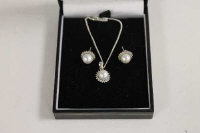 A 9ct white gold pearl and diamond pendant, on sterling silver chain, together with the matching earrings. (3)