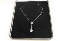 A 14ct white gold diamond and topaz drop pendant on chain.
