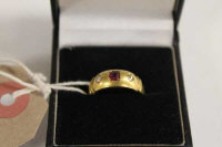 An 18ct gold two stone diamond and ruby ring.