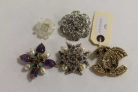 Five Chanel costume brooches, set with faux multi-gemstones. (5)