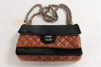 A Chanel brown stitched leather and fur shoulder bag, with authenticity guarantee card no. 10786071.
