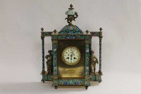 A nineteenth century French cloissone mantle clock, striking on a bell, the pillared sides mounted with figures cast in brass, height 50 cm.