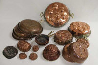 Nineteen nineteenth and later century copper kitchen items including jelly moulds, lids, pans, sieves etc.