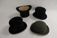 A Lock & Co Gentleman's silk top hat, boxed, together with two other top hats and a Dunn & Co bowler hat. (4)