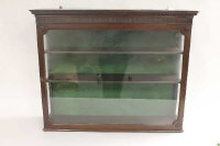 An Edwardian mahogany glazed shop display cabinet, width 79.5 cm.