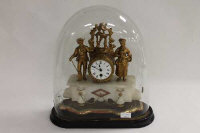 A nineteenth century French gilt metal and white onyx mantle clock under shade, width 40 cm.
