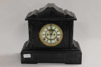 A Victorian black slate and green marble mantle clock, width 33 cm.
