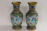 A pair of early twentieth century cloisonne vases, decorated with birds in flight amongst foliage, height 38.5 cm. (2)