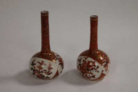 A pair of miniature Japanese Kutani bottle vases, signed. (2)