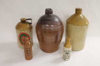 A collection of twenty-nine stoneware flagons and advertising stoneware. (29)