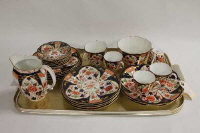 A Royal Crown Derby part tea and coffee set, pattern 6041, together with nine further items of china in the Imari pallet. (33)
